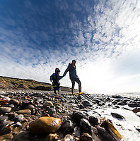 Mother and son searching for Isle of Wight Dinosaurs on Compton Beach