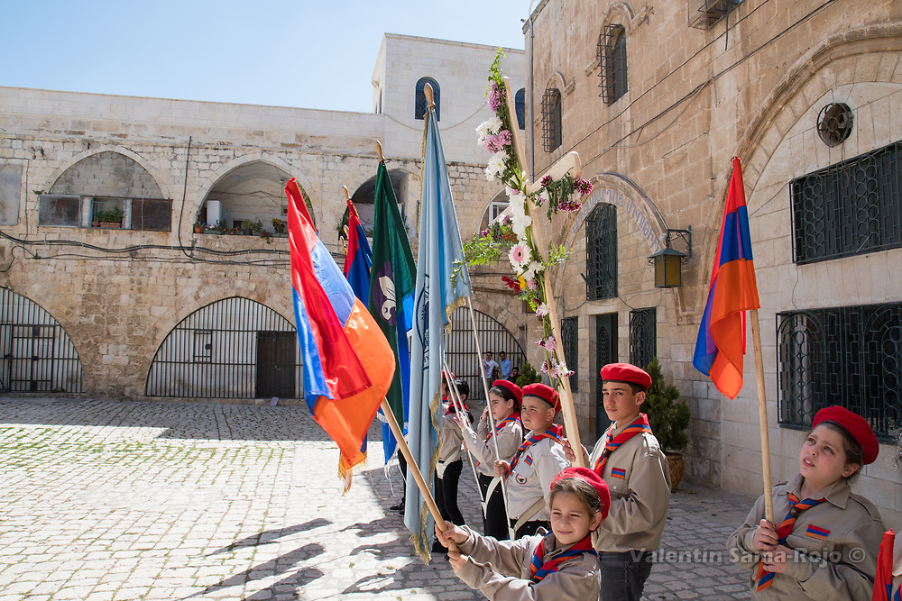 Jerusalem, Israel. 1st April, 2018. Kids of the Armenian Scout Troop carrying a cross decorated with flowers and Armenian Flags during Armenian Palm Sunday procession. © Valentin Sama-Rojo.