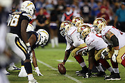 the San Francisco 49ers offensive line gets set to snap the ball at the line of scrimmage opposite the San Diego Chargers defensive line during the 2016 NFL preseason football game against the San Diego Chargers on Thursday, Sept. 1, 2016 in San Diego. The 49ers won the game 31-21. (©Paul Anthony Spinelli)