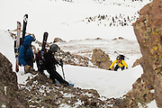 Backcountry skier Judd MacRae gains the summit ridge of Hayden Peak and his waiting friends, San Juan Mountains, Colorado.