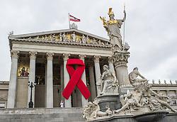 THEMENBILD - Rote Schleife am Parlament. Die Rote Schleife ist das Symbol zur Solidaritaet fuer HIV Infizierte und AIDS Kranke. Das Bild wurde am 28. Mai 2014 aufgenommen. im Bild Rote Schleife am Haupttor des oesterreichischen Parlaments // THEMES PICTURE - Red Ribbon on Austrian Parliament. The Red Ribbon is the symbol for solidarity of people living with HIV / AIDS. The image was taken on may, 28th, 2014. Picture shows Red Ribbon on main gate of the Austrian Parliament, AUT, EXPA Pictures © 2014, PhotoCredit: EXPA/ Michael Gruber