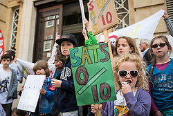 © Licensed to London News Pictures. 03/05/2016. London, UK. Parents and children gather outside the Department for Education before handing in a petition to Secretary of State for Education Nicky Morgan demanding that Year 2 SATs be scrapped. Thousands of parents are keeping their children out of school as part of a boycott of the exams. Photo credit: Rob Pinney/LNP
