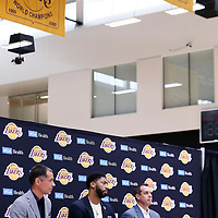 EL SEGUNDO, CA - JUL 13: Anthony Davis answers journalists next to General Manager Rob Pelinka and Head Coach Frank Vogel during a press conference on July 13, 2019 at the UCLA Health Training Center, in El Segundo, California.