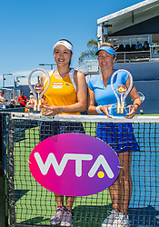 August 5, 2018 - San Jose, CA, U.S. - SAN JOSE, CA - AUGUST 05: Latisha Chan (TPE) and Kveta Peschke (CZE) hold their championship trophies on the court net for the WTA Doubles Championship match at the Mubadala Silicon Valley Classic on the San Jose State University Stadium Court in San Jose, CA  on Sunday, August 5, 2018. (Photo by Douglas Stringer/Icon Sportswire) (Credit Image: © Douglas Stringer/Icon SMI via ZUMA Press)