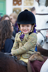 © Licensed to London News Pictures. 26/12/2017. Market Bosworth, Leicestershire, UK. The Hunt meeting in the Market Square, Market Bosworth earlier today. Pictured, Rose Cassapi Paskins (Five) taking part with her family in the hunt parade. Photo credit: Dave Warren/LNP