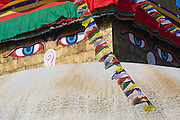 Detail of Boudhanath Stupa and prayer flags, Kathmandu, Nepal.