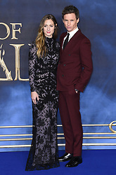 Eddie Redmayne and Hannah Bagshawe attending the Fantastic Beasts: The Crimes of Grindelwald UK premiere held at Leicester Square, London. Photo credit should read: Doug Peters/EMPICS