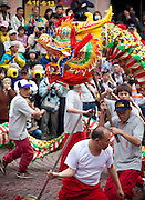 Traditional Chinese dragon dance at a religious festival in Taipei, Taiwan. In Chinese culture, dragons are believed to bring good luck to people.