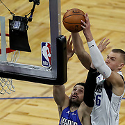 ORLANDO, FL - MARCH 01: Kristaps Porzingis #6 of the Dallas Mavericks slam dunks the ball over Nikola Vucevic #9 of the Orlando Magic during the second half at Amway Center on March 1, 2021 in Orlando, Florida. NOTE TO USER: User expressly acknowledges and agrees that, by downloading and or using this photograph, User is consenting to the terms and conditions of the Getty Images License Agreement. (Photo by Alex Menendez/Getty Images)*** Local Caption *** Kristaps Porzingis; Nikola Vucevic
