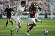 Andre Ayew of West Ham United (R) battling with Federico Fernandez of Swansea City (L). Premier league match, West Ham Utd v Swansea city at the London Stadium, Queen Elizabeth Olympic Park in London on Saturday 8th April 2017.<br /> pic by Steffan Bowen, Andrew Orchard sports photography.
