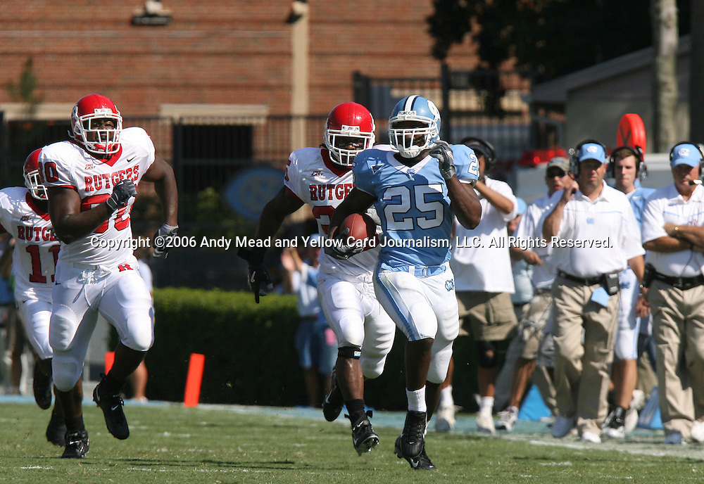 02 September 2006: UNC's Ronnie McGill (25) breaks free for a 48 yard run down the sideline. He is chased by Rutgers Jamaal Westerman (90) and William Beckford (35). The University of North Carolina Tarheels lost 21-16 to the Rutgers Scarlett Knights at Kenan Stadium in Chapel Hill, North Carolina in an NCAA Division I College Football game.