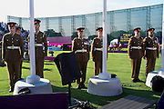 British army soldiers at the Royal Artillery Barracks, South London, prepare to hoist the flags of winning nations in the paralympic archery finals