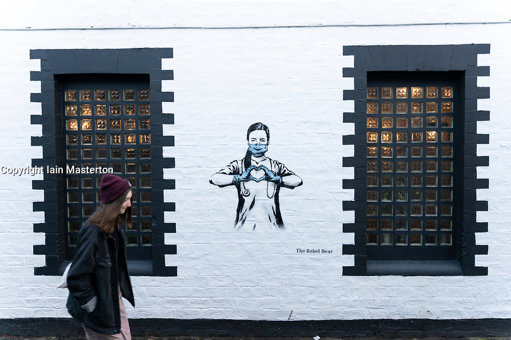 Glasgow, Scotland, UK.1 December 2020. Glasgow remains under level 4 lockdown and non essential businesses, bars and restaurants are closed. Pictured; Street art by Rebel Bear on Ubiquitous Chip restaurant in West End.  Iain Masterton/Alamy Live News