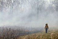 A burn crew member walks along the edge of prescribed burn in a field at Glory Hill on the Mohonk Preserve to make sure the fire does not spread on Thursday, April 16, 2009.