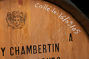 An oak barrel stamped with Gevrey Chambertin, the Jadot Bacchus symbol and with chalk writing that the wine has been fined clarified on September 9 2005, Maison Louis Jadot, Beaune Côte Cote d Or Bourgogne Burgundy Burgundian France French Europe European
