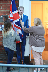 Royal fans admire a cardboard cut-out of Prince Harry in Windsor ahead of the wedding of Prince Harry and Meghan Markle n St George's Chapel in Windsor Castle.