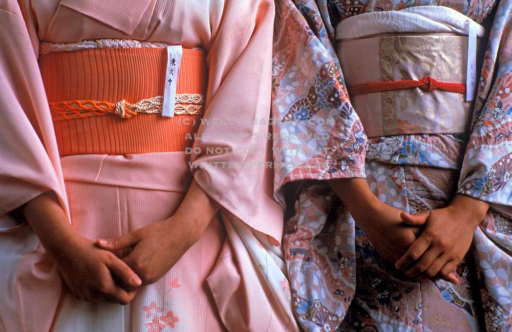 Image of two women wearing silk kimonos, Nara, Japan by Randy Wells
