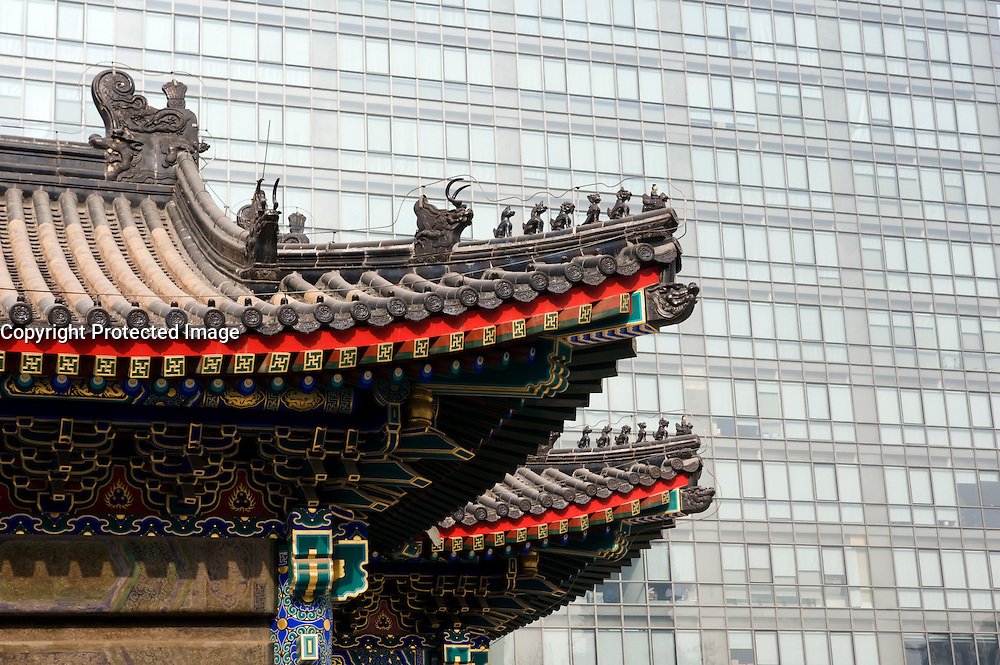 Contrast between old traditional temple building and new high rise offices in financial district of Beijing 2009