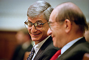 Secretary of the Treasury Robert Rubin smiles at Federal Reserve Chairman Alan Greenspan during testimony before the House Banking hearings May 20, 1999 in Washington, DC.