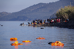 November 11, 2015 - Lesbos, Lesbos, Greece - Lesvos island, Greece in November 2015. Refugees continue to arrive every day. Although the remaining when they are saved are floating on the water, the lifejackets. Floating life jackets and refugees on dingies.  Most of those lifejackets and rings are fake and low quality. Some of them are just bicycle tubes. (Credit Image: © Nicolas Economou/NurPhoto via ZUMA Press)