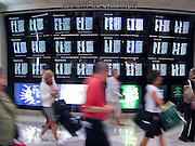 27 JULY 2007 -- PHILADELPHIA, PA: People walk through the terminal and look at the flight status board in Philadelphia International Airport in Philadelphia, PA. PHOTO BY JACK KURTZ