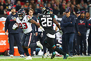 Houston Texan's running back, Carlos Hyde (23) runs with the ball during the NFL game between Houston Texans and Jacksonville Jaguars at Wembley Stadium in London, United Kingdom. 03 November 2019