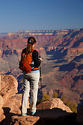 Hiker at Ooh-ahh Point on the South Kaibab Trail, Grand Canyon National Park, Arizona. (Model Released)