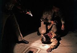 Police arrest a man at gunpoint in San Diego, California.