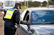 A woman is fined $1652 for breaking stage 3 restrictions as she passed through a roadblock south of Gisborne as Melbourne plunges back into Stage 3 lockdowns during COVID 19. After a sustained outbreak across Melbourne, Stage 3 lockdowns re-commence across the city today along with one regional shire, Mitchell. Residents can only leave their home for four reasons from midnight last night. Police are setting up roadblocks across Melbourne to stop anyone flouting the rules and will check an unprecedented number of drivers as well as door knock the effected areas. Stats across Australia are now completely closing their borders to Victorians. This comes after 118 new coronavirus cases being discovered Tuesday night bringing the total cases in Victoria to 860. (Photo be Dave Hewison/ Speed Media)