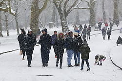 © Licensed to London News Pictures. 24/01/2021. London, UK. People brave the snow in Finsbury Park, north London as large parts of the UK are expected to be blanketed in snow and freezing conditions. According to the Met Office, the cold weather could bring up to 10cm of snow to some parts of the country and an amber weather warning for snow and ice is in place across much of the UK. Photo credit: Dinendra Haria/LNP