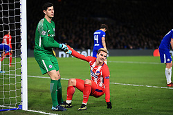 5 December 2017 -  UEFA Champions League (Group C) - Chelsea v Atletico Madrid - Chelsea goalkeeper Thibaut Courtois  pulls Antoine Griezmann of Atletico Madrid to his feet - Photo: Marc Atkins/Offside