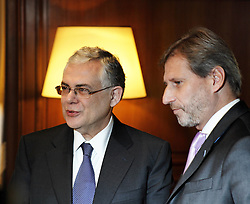 Greek Prime Minister Lukas Papademos and European Commissioner for Regional Policy Johannes Hahn. Mr Papademos met with Commissioner Hahn in his office and discussed the course of Greek economy and other relevant issues. Athens, Greece, Maximou Mansion, 13.12.2011. Photo By Imago/i-Images