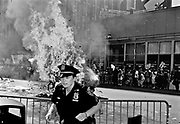 """NEW YORK - More than 400, 000 demonstrators marched past a heavily fortified Republican convention hall on Sunday, chanting denunciations of the administration and the war in Iraq as delegates flocked to the city to nominate President Bush for four more years in the White House. <br /><br />Bush and Kerry are locked in a tight race for the White House, although recent polls suggest momentum for the president. A group of Vietnam veterans have been running commercials accusing Kerry of lying about his decorated service in Vietnam, allegations that official Navy documents dispute and Kerry has denounced as a Republican-driven smear. Still, fellow Democrats concede the unsubstantiated claims may be hurting his candidacy.<br /><br /> Polls show the war in Iraq has become increasingly unpopular in recent months, and the throng of protesters filling 20 city blocks on a steamy Manhattan afternoon underscored that. """"No More Bush,"""" and """"No More Years,"""" were two of the more popular chants. """"Bush Lies, Who Dies?,"""" read some of the signs.<br /><br /> Several protesters carried flag-draped, coffin-shaped boxes through the streets, meant to draw attention to the U.S. death toll in Iraq.<br /><br /> Police gave no official crowd estimate of the day's protest. One official put the size at 120,000, although it took nearly five hours for the procession to pass Madison Square Garden. Delegates meet there beginning Monday to nominate Bush and Cheney for second terms.<br /><br /> Organizers claimed they had turned out roughly 400,000 protesters.<br /><br /> In all, about 100 arrests were reported, with no major outbursts of violence. At mid-afternoon, a small fire erupted along the protest route a half block from the Garden. Police quickly doused the flames, then handcuffed two people and led them away.<br /><br /> Thousands of police, some dressed in riot gear, others bearing automatic weapons, watched as the protesters passed. Extensive as it was, the force represented only a portion o"""