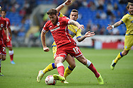 Aron Gunnarsson of Cardiff city ® breaks away from Chris Maguire of shelf Wed. Skybet football league championship match, Cardiff city v Sheffield Wed at the Cardiff city stadium in Cardiff, South Wales on Saturday 27th Sept 2014<br /> pic by Andrew Orchard, Andrew Orchard sports photography.