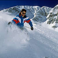 Todd Lund shreds new powder snow on Cue Ball run, below Lone Mountain at Montana's Big Sky Ski Resort.
