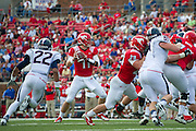 DALLAS, TX - NOVEMBER 16: Garrett Gilbert #11 of the /SMU Mustangs drops back to pass against the Connecticut Huskies on November 16, 2013 at Gerald J. Ford Stadium in Dallas, Texas.  (Photo by Cooper Neill/Getty Images) *** Local Caption *** Garrett Gilbert