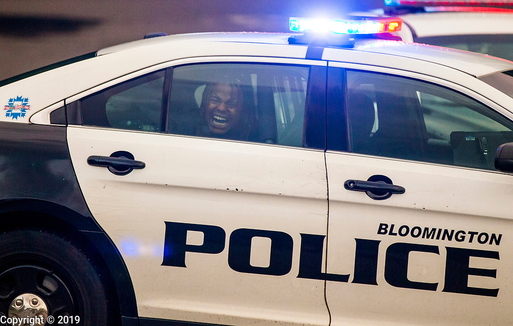 Xavier Butler yells while in the back of a police car after being arrested July 27, 2018 in Bloomington, Ind.
