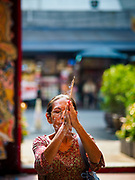12 FEBRUARY 2018 - BANGKOK, THAILAND: A woman prays at the Poh Teck Tung Shrine in Bangkok's Chinatown neighborhood.     PHOTO BY JACK KURTZ