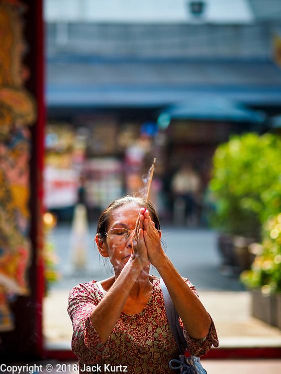 12 FEBRUARY 2018 - BANGKOK, THAILAND: A woman prays at the Poh Teck Tung Shrine in Bangkok's Chinatown neighborhood.     PHOTO BY JACK KURTZ
