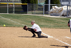 05 April 2008: Jacquelyn Tassone crouches to scoop up a low throw. The Carthage College Lady Reds lost the first game of this double header to the Titans of Illinois Wesleyan 4-1 at Illinois Wesleyan in Bloomington, IL