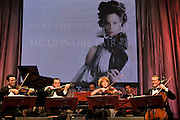 Moscow, Russia, 28/09/2005..The first Millionaire Fair in Moscow at the Crocus City Expo Centre attracted thousands of would-be and existing Russian millionaires to view and purchase a wide range of luxury goods. Orchestra greets visitors to the fair..