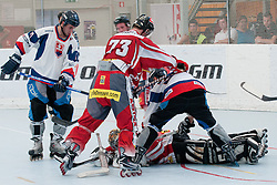 Goalie of Austria Markus Schilcher covers a puck at inline hockey match between Slovakia and Austria at HorjulCup, on June 10, 2011 in Sportni park, Horjul, Slovenia. (Photo by Matic Klansek Velej / Sportida)