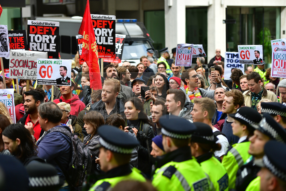 © Licensed to London News Pictures. 08/04/2016. London, UK. Uncut protestors storm the Conservative Party Spring Forum in central London.  Conservative party leader and British prime minster David Cameron has come under pressure after it was revealed that he had  investment in an offshore fund.  Photo credit: Ben Cawthra/LNP
