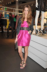 ROSIE HUNTINGTON WHITELEY at a party to celebrate the launch of the Matthew Williamson collection at H&M held at the H&M store, Regent Street, London on 22nd April 2009.