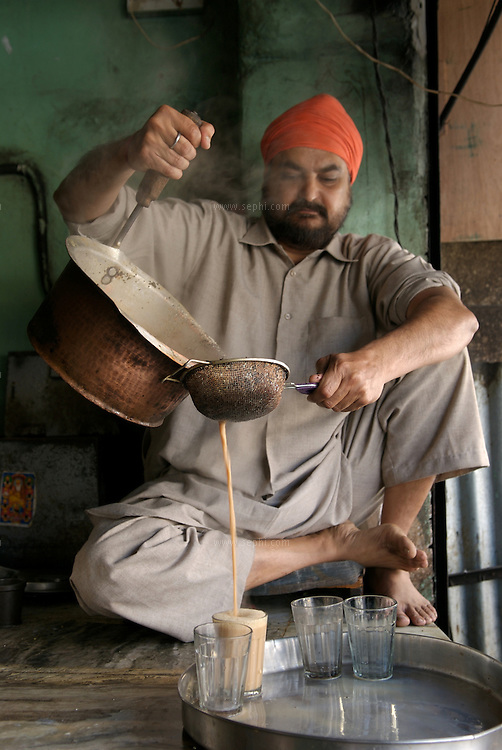 Gurmeet Singh presides over the tea kettle at Giani Tea Stall on Circular road, Amritsar. The shape of the tea kettle, more precisely, the location of the handle on the kettle, is unique for Amritsar