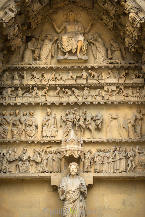 Close-up of relief sculptures above entrance to Cathedral of Notre-Dame in Reims, France