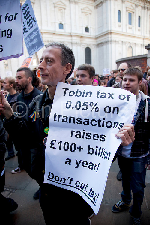 """Gay rights activist Peter Tatchell joins in with the protest at Occupy London protest, October 15th 2011. Protest spreads from the US with this demonstrations in London and other cities worldwide. The 'Occupy' movement is spreading via social media. After four weeks of focus on the Wall Street protest, the campaign against the global banking industry started in the UK this weekend, with the biggest event aiming to """"occupy"""" the London Stock Exchange. The protests have been organised on social media pages that between them have picked up more than 15,000 followers. Campaigners gathered outside  at midday before marching the short distance to Paternoster Square, home of the Stock Exchange and other banks.It is one of a series of events planned around the UK as part of a global day of action, with 800-plus protests promised so far worldwide.Paternoster Square is a private development, giving police more powers to not allow protesters or activists inside."""