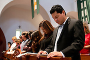 Juan Enriquez prays with his family during mass at St Ann Catholic Parish in Coppell, Texas on October 12, 2014. (Cooper Neill for The New York Times)