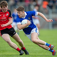 Cratloe's Cathal McInerney tries to get past Clondegad's Peter Casey