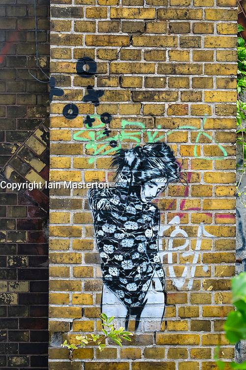 New stencilled street art of woman by artist XOOOOX in Berlin Germany